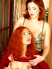 Red-haired girls having a lesbo after-party with hot kisses and a dildo fun