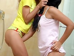 Superb young teen lesbians Stephanie and Isabel lick and toy raw pussies at the douche