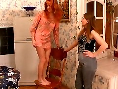 Raunchy mature gal mounting the table for some French sex with younger girl