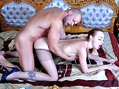 Pretty redhead with nice boobs gets her pantyhose lowered for a juicy fuck