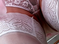 A mature woman in stockings in these upskirt pics