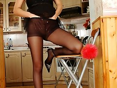 Nasty chick in classic pantyhose giving her nyloned snatch a supreme exercise