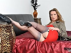 Wonderful Jane is dressed in a tight red dress and some beautiful stockings.
