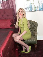 Ashleigh teasing and playing with herself in the bedroom in retro lingerie nylons and heels, all...