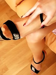 Heated gal in shiny pantyhose willingly filling her mouth with nyloned foot
