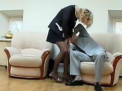 Steamy secretary giving manmeat a cute tug blowing on it through black tights