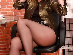 Angel at the office with ebony pantyhose mask