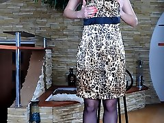 Nude girl wears her flowery print nylons with a tiny lacy garter for a date