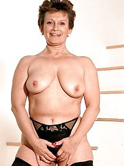 Hot granny Stella flaunting her hot body and knearing her huge tits.