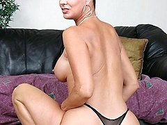 Hot GILF Vanessa Videl showing off her big tits and ass and spreading her thigh to examine her...