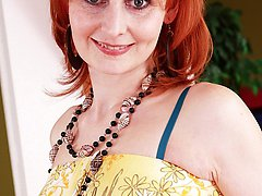 Mature redhead Bachova fingers box wearing only stockings.