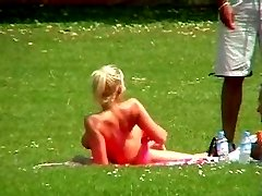 Drunk amateur chick getting naked and nasty on the grass in the public park