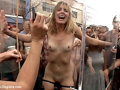 Mona Wales is a tough cookie. She loves choking, spitting, face fucking and anal. She is the ultimate attention whore and loves to be degraded and humiliated in public. Will this be her most challenging shoot yet? Will this slut finally get enough disgrace to satisfy her whorish desires? First she gets a basic fucking over in a filthy bathroom- takes nasty cocks in the ass, a crowd of perverts and a face full of cum. But Ariel X is not through with her yet! Mona gets dragged outside and paraded through folsom street fair with painful electricity coursing through her body. Ariel prods her onward with a cane and a flogger and she ends up on the kink.com stage performing the ultimate act of humiliation.watch and find out! Pissing, face fucking, anal, electricity, bondage, extreme emotional humiliation.