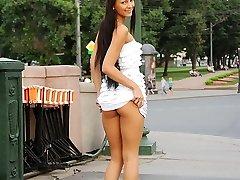 Hot teenage minx demonstrates her perky tits in public - publicsexadventures.com
