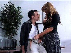Carmen Cruz has had her eye on Steven, the mail boy, for quiet some time now. She flirts with him everyday and fantasizes about fucking his tight ass every night. Today Carmen finally has her chance to act on her secret desires. Seduction in the office has never tasted so sweet.
