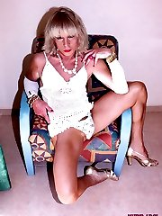 TGirl Kim is relaxing on her sofa in some sexy lingerie and decided to get the toys out and fuck...
