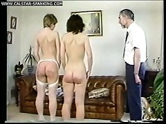 Two filthy bitches spanked & caned in stockings and fully nude