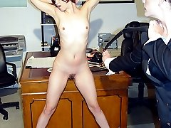 Stunning secretary lowers her panties for an acoss the desk caning