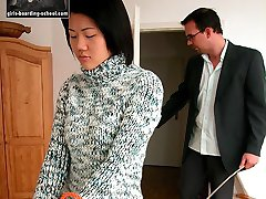 Pretty asian babe tied to the bed and caned hard on bare ass
