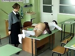 Classroom caning for bare bottom pupil in tears of shame and pain