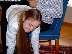 Pretty schoolgirl taken over the knee for a a good sound spanking