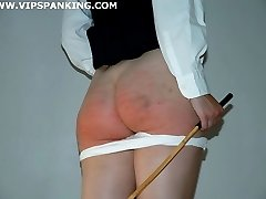 Young Schoolgirl gets the cane on her round bared cheeks