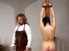 Brunette Pigtail Girl receiving a super-strong Caning