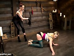 Welcome newcomer Bailey Blue to Whipped Ass. Bailey is new to punishment and submission but comes with an eagerness to learn and please. Maitresse Madeline shows Bailey the ropes and teaches her that all little pain sluts have to start at her feet. Bailey takes gloved OTK spankings, evil zipper, pussy torture and is made to lick Madeline's pussy to earn a deep strap-on anal fuck!