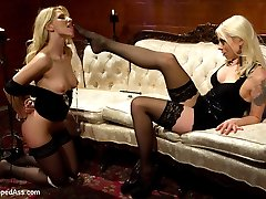 Lorelei Lee and Ashley Fires are both killer dommes who just happen to have a crush on one another. The secrets out and both have been dying for a power exchange between them. We throw these two smoking hot blonde dominatrices into a room to see what happens and what happens is a beautiful thing. Both girls end up being taken down and dominated by the other at some point in the day. This is the first time we will ever see Ashley Fires totally dominated and punished by a woman at Kink.com! Watch as the girls go back and forth one upping the other until they are wrestling in a pile of hot sweat, blonde hair and brutal ass fucking! Don't miss out on this rare and genuine glimpse of what happens when two dominant women take turns switching!
