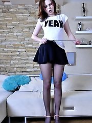 Naughty teen girl strips to her black suspender tights to use a rubber cock