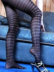Sultry brunette admires the look of her legs and ass in patterned pantyhose