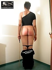 Caned across her meaty naked rump - severe stripes and weals
