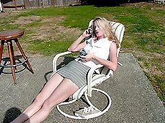 Sunbathing wife spanked by angry husband outdoors