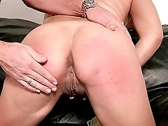 Mature blonde playing with her pussy after hand caning