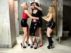 Gia Dimarco arrives to the Armory thinking she is going to shoot Divine Bitches with three of her fellow dominatrix yet we have another plan for her! After the opening interview with the male sub Gia ventures off to the bathroom where Maitresse Madeline, Aiden Starr and Lorelei Lee take her down right from the bathroom stall! Gia has been domming for  two years now and had to be reminded of where she came from. The dommes spray her down and attempt to wash the whore from her and gets spanked hard but Gia just squirts all over! She's bound spread and takes single tail lashings, cat o' nine tails and flogging all at the same time! She's suspended and ass plugged, strap-on fucked and fisted. Finally, Gia, completely broke down begs for three canes at once while strap-on ass fucked! This is one Whipped Ass update you do not want to miss!