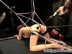 Exotic beauty Marsha Lord is dressed in latex and dominated by Claire Adams in this spectacular fetish update.  Marsha is bound in Claires creative and elaborate rope bondage where she experiences different sensations both pleasurable and painful.  Featuring a semitransparent hood that reduces her vision to a blur, a steel ass hook, clamps, strap-on sex and more.