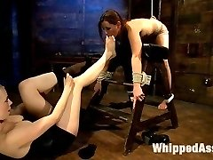 Welcome Hope to WhippedAss.com. Hope is only 20 years old, brand spanking new to BDSM, cute as a button and willing to get tied up and dominated by the amazingly sexy Lorelei Lee even though she has no idea what she's gotten herself into. Lorelei pushes Hope right to her limits treating her like a rag doll and showing her what lesbian BDSM is all about. Flogging, crop, foot worship, bondage, pussy licking and strap-on fucking are all included.