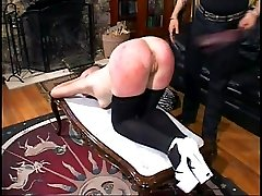 Brutal spanking caning and strapping for bent over girl in pain - battered and bruised ass