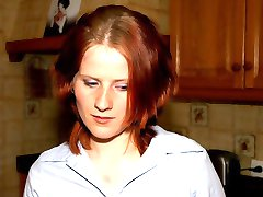 Horny redhead bent over the kitchen table and caned on her swelling cheeks