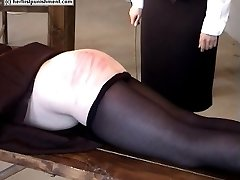 Hot blistered rump cheeks from severe naked bottom caning