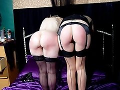 2 sluts spank each other brutally on their bared bottoms