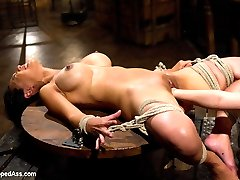 Welcome Tia Ling back to Whipped Ass in one of her hottest movies yet! In the first scene Tia is strung up by a brutal crotch rope parting her beautiful pussy lips while she is whipped, choked and has her large full breasts humiliatingly milked by Aiden Starr! Tia is then oiled up and tied to a chair in such a way that her round ass is perched up for a tough spanking until her ass is deep red. She then has her pussy lips adorned with clamps and weights and her ass penetrated with an acrylic dildo. Aiden discovers more milk dripping from this hard-bodied slut's tits and fists and fucks her making her milk her own tits and receive pain as she cums. All at the same time! As if that's not enough Tia is made to lick ass and bent over and strap-on ass fucked in doggie style until every orgasm is ripped from her hot body!