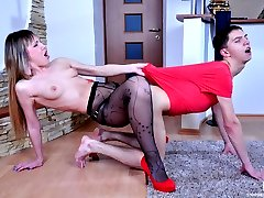 Red hot babe reveals a strap-on cock before rimming and ass banging her guy