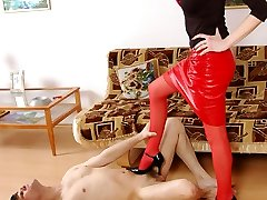Strap-on armed chick treating a guy like her submissive and dirty sex toy