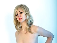 Blonde Helga shows off her great tits and big strapon cock