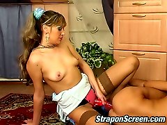Stockinged chick armed with strap-on going down into mind-blowing quickie