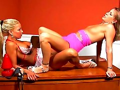 Two nasty lesbian cuties fuck with a double dildo then strap on dildo