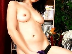 Hot young thing slides a strap on in her man's dirty hole!