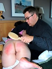 A servere wooden brush spanking for a big bottomed Cutie