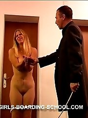 Naked blonde lovely caned hard on her hands and full round ass